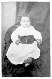 "carte de visite portrait of a ""prison baby"" (Willis D. Mason, born November 6, 1875) taken by Zalmon Gilbert at his studio in Joliet, Illinois, and appears to be of a child born to a woman held in prison."